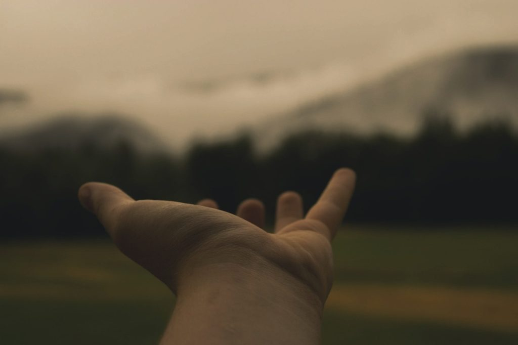 Hand Reaching Out For Forgiveness