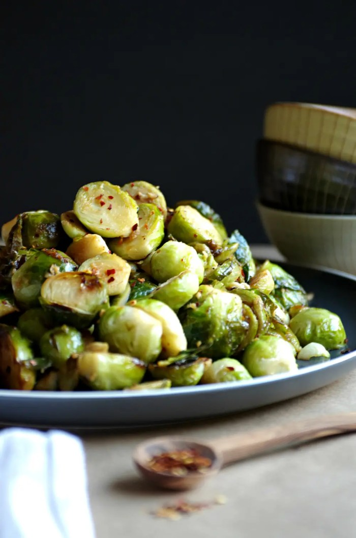Plate with a large serving of Sautéed Brussels Sprouts with Lemon and Garlic and sprinkled with red chili flakes