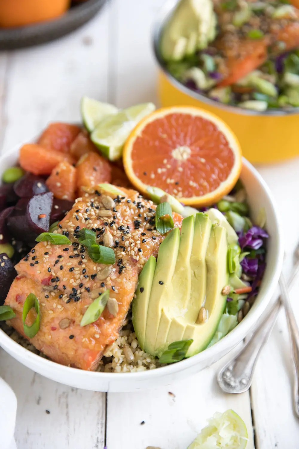 Super healthy foods like freekeh, beets, oranges, and avocado are just part of what make this nutritious 30 minute Sweet Chili Miso Salmon Salad a dinner win any night of the week!
