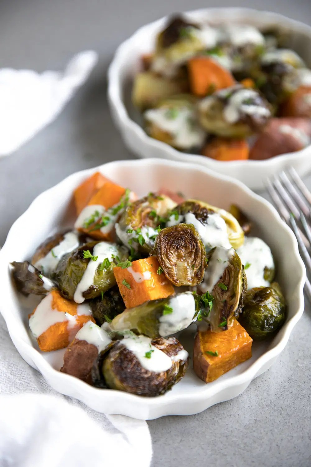 Easy Roasted Brussels Sprouts and Sweet Potatoes with Tahini Sauce
