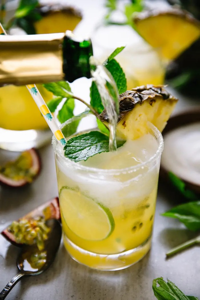 Filling pineapple margaritas with champagne