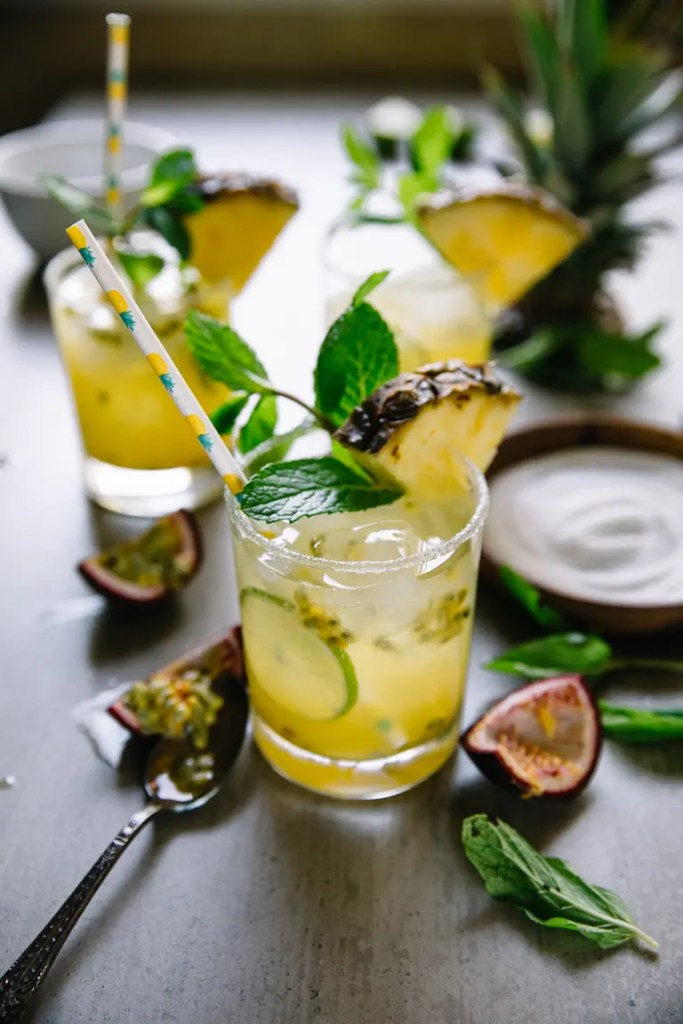 Pineapple Margaritas filled with tequila, champagne, fresh pineapple, mint, and lime juice