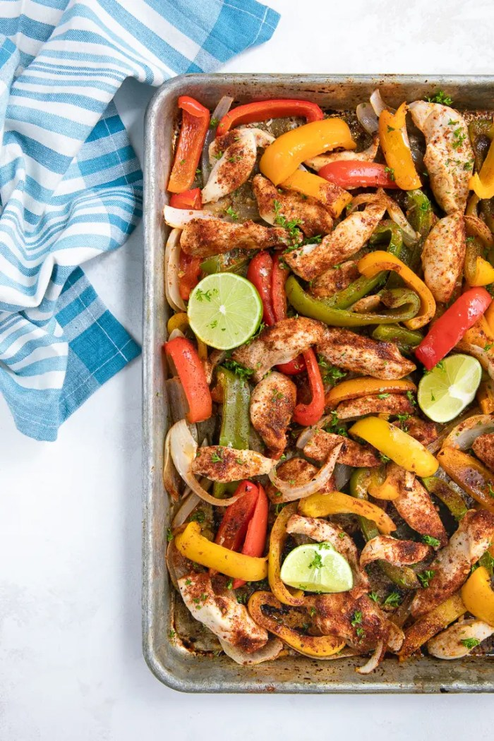 Prepared Sheet Pan Chicken Fajitas with bell pepper and onion