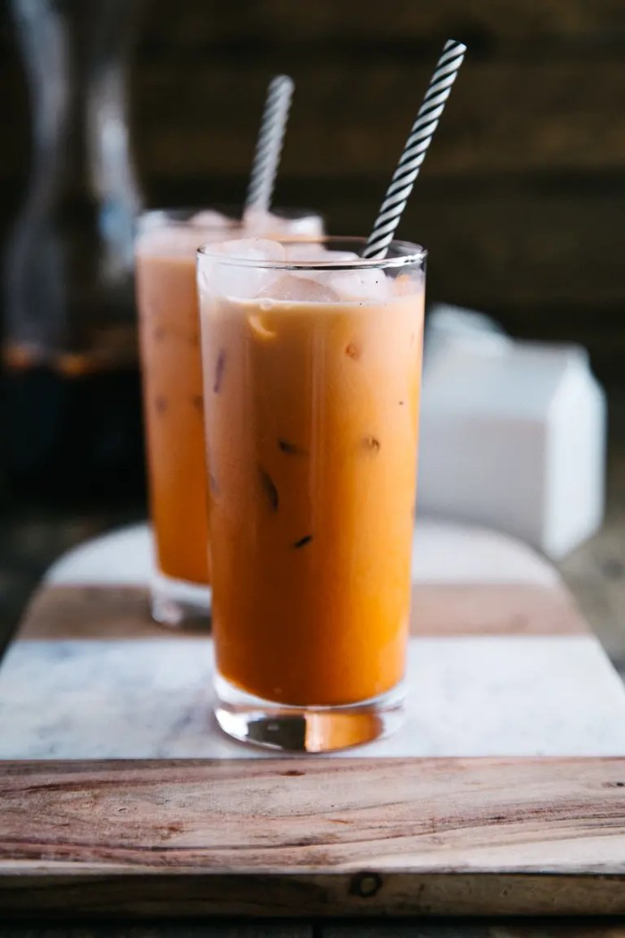 Two glasses filled with cold prepared Thai Iced Tea