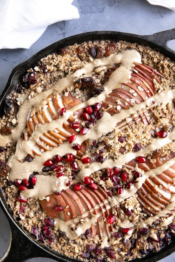 Baked oatmeal in cast iron skillet with pears and cashew butter glaze