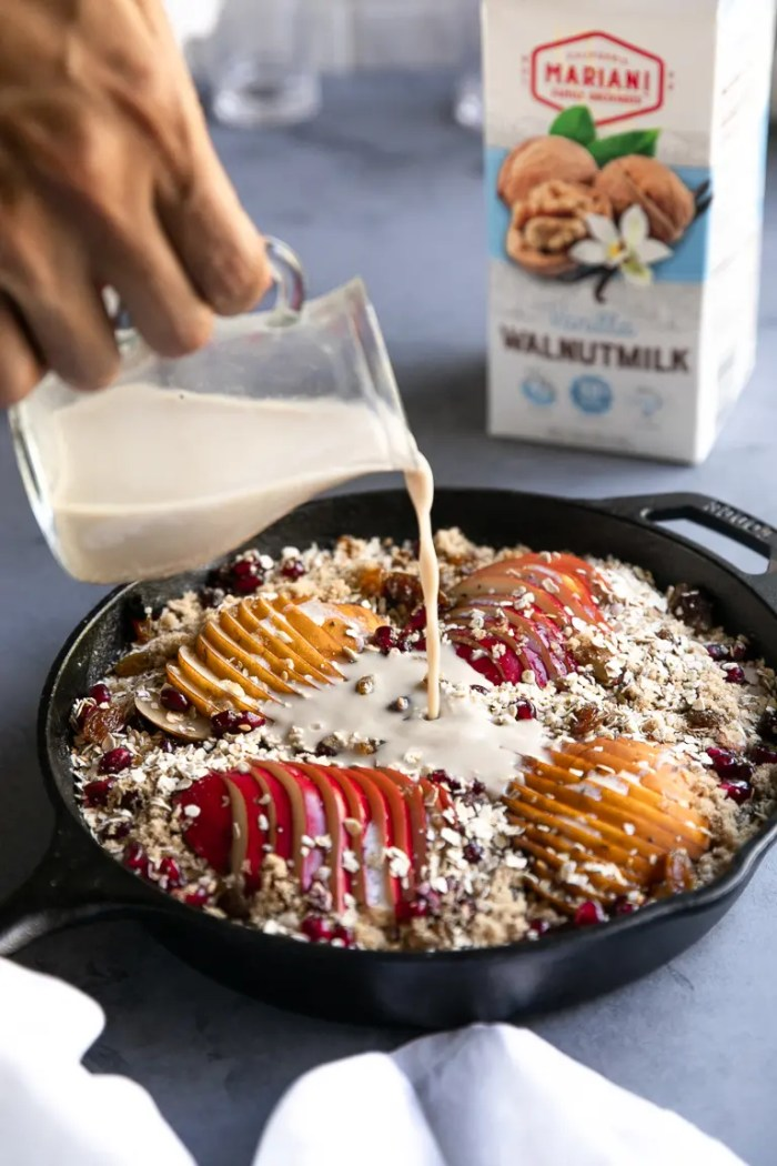 Pouring Walnutmilk into baked oatmeal skillet