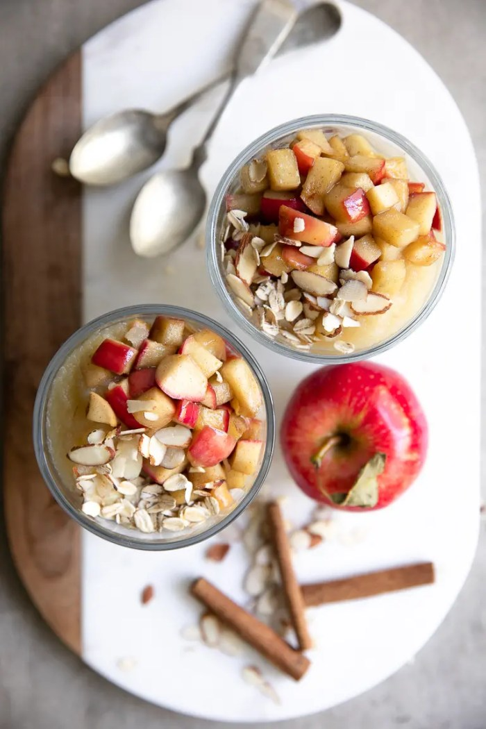 Overhead view of two glass jars filled with apple cinnamon overnight oats.