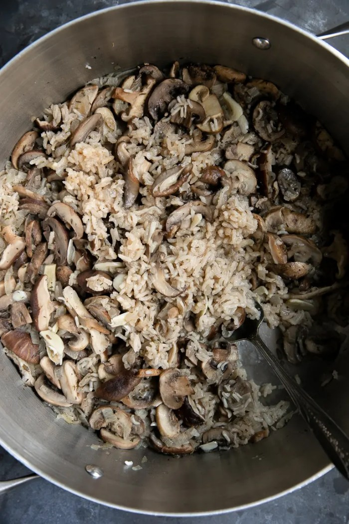 Fully cooked mushroom rice pilaf in a large steel pot.