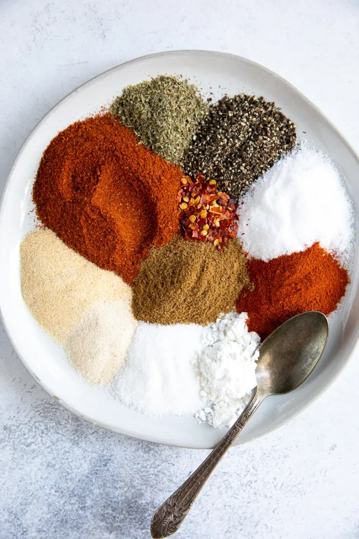 White plate filled with all the ingredients to make taco seasoning.