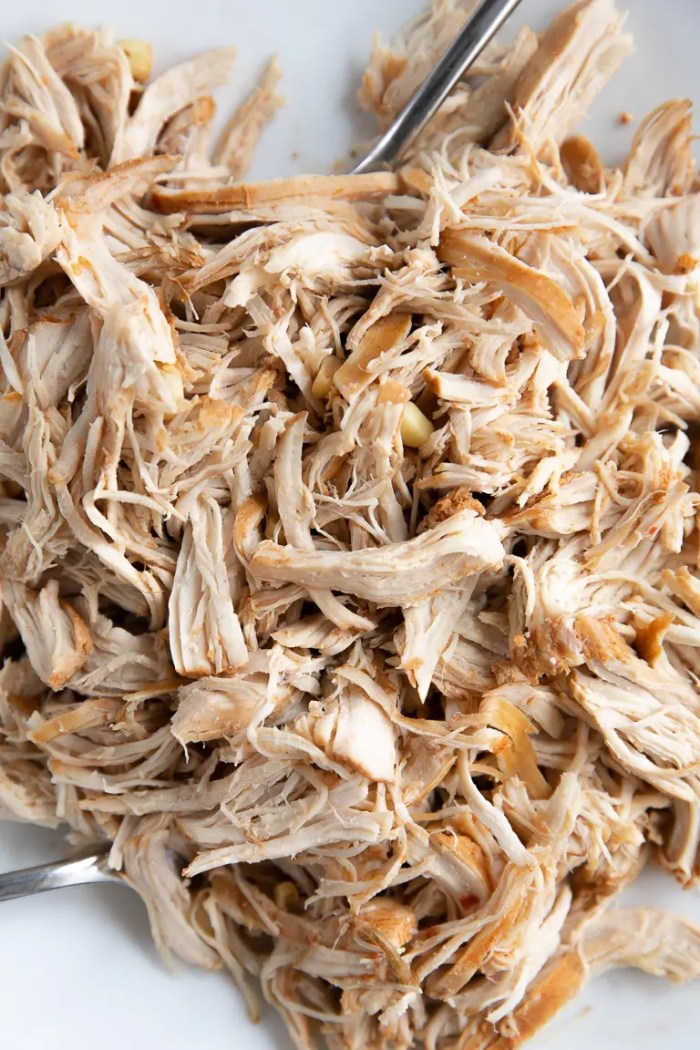 Fully cooked and shredded chicken.