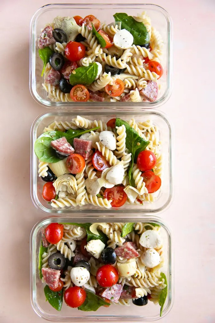 Three meal prep containers filled with leftover Italian Pasta Salad.