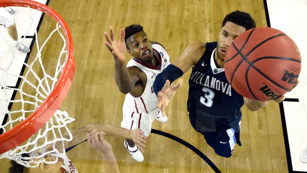 Villanova's Josh Hart scores a layup against Oklahoma's Buddy Hield during the Wildcats' 95-51 victory in the Final Four at NRG Stadium on Saturday. (Photo by Chris Steppig - Pool/Getty Images)
