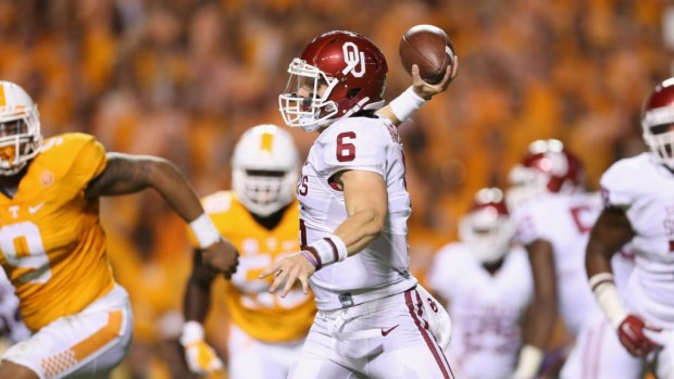 Oklahoma quarterback Baker Mayfield, here escaping at Tennessee, got his 2017 season restored on Thursday as the Big 12 faculty athletic representatives voted 7-3 in favor of an amended rule change that allows walk-ons to transfer in the conference without losing a year of eligibility.