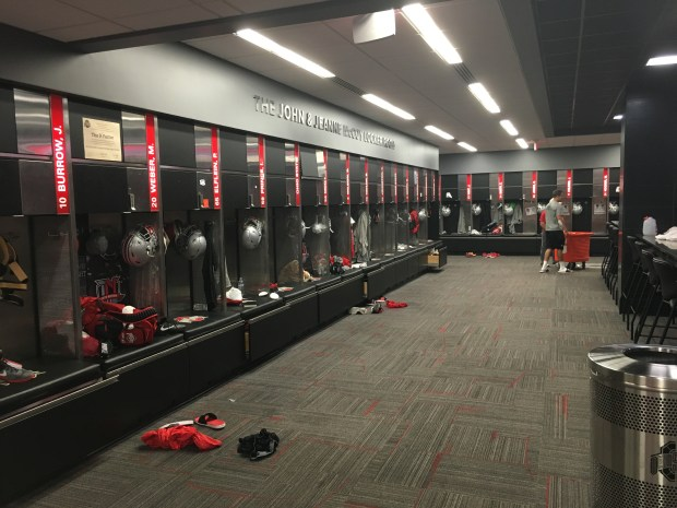 An equipment manager tends to the locker room ahead of Saturday's game versus Tulsa. (PHOTO: John E. Hoover)