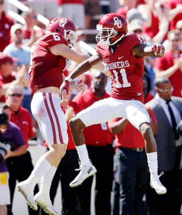 OU wideout Dede Westbrook celebrates one of his three long touchdowns Saturday against Texas with quarterback Baker Mayfield. (PHOTO: Ty Russell, OU media relations)