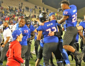 After beating Cincinnati on Friday night, Tulsa players flooded the field in celebration. (PHOTO: John E. Hoover)
