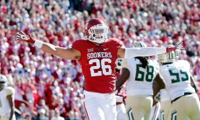 Oklahoma linebacker Jordan Evans exults his big day Saturday against Baylor: 9 tackles, 2 interceptions, 2 sacks, 2 passes broken up. OU beat the Bears 45-24. (PHOTO: Ty Russell/OU media relations)