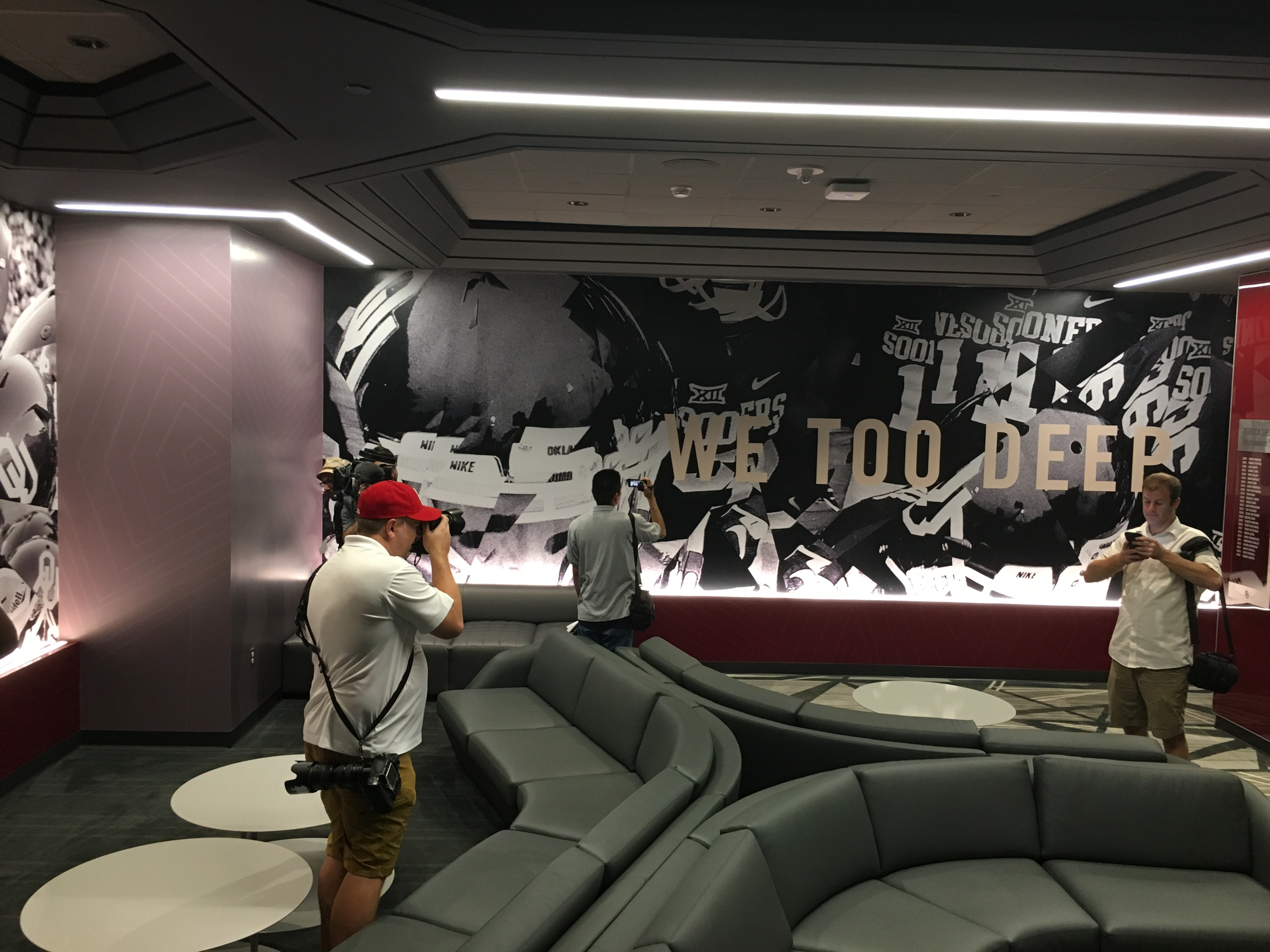 Photographers In The Players Lounge Capture Images Of OUs New Stylized Murals Throughout Facility PHOTO John E Hoover