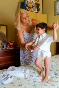 Happy little Tiago in the top half of his christening clothes!....