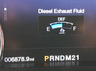 Adding 2.5 Gallons DEF - Tank Now Half Full