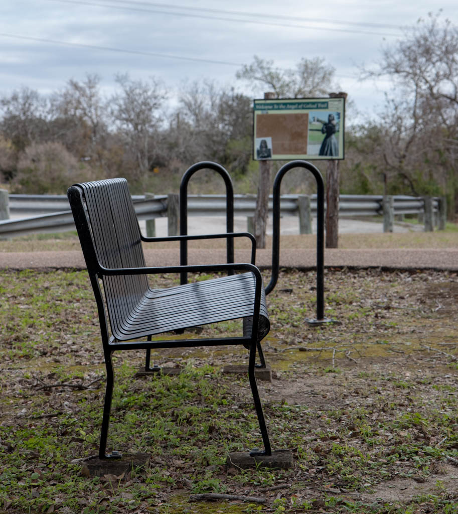 Park Bench And Information Sign