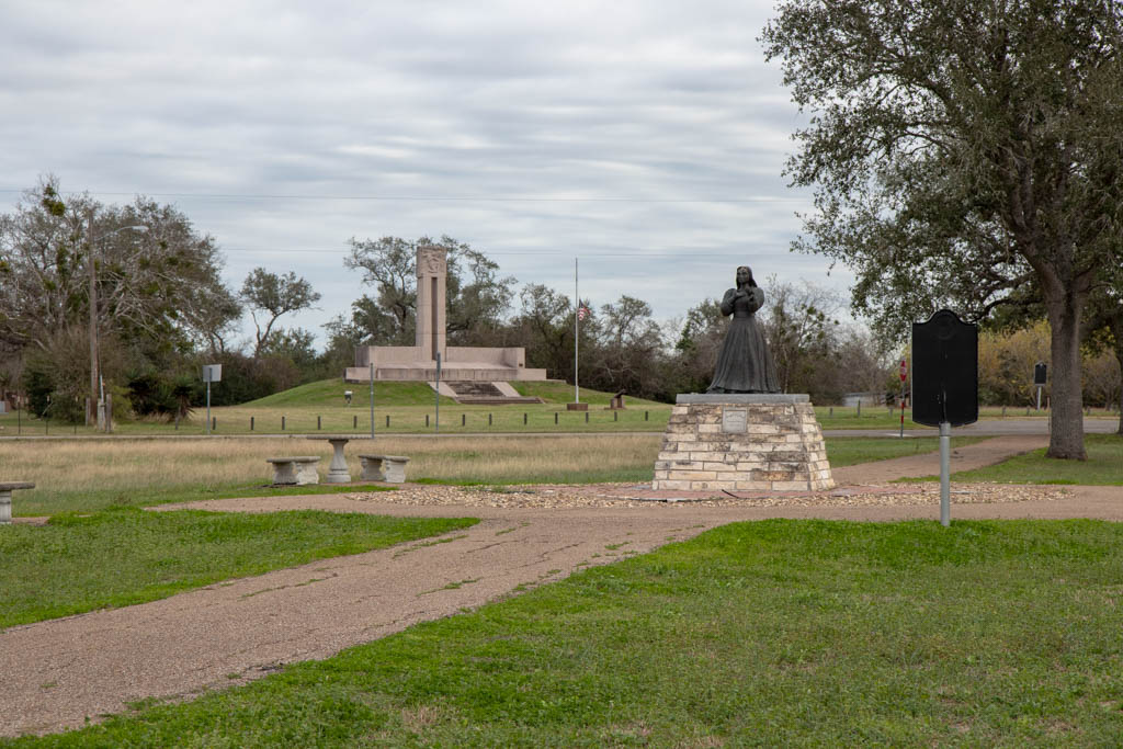 Angel of Goliad Statue With Fannin Monument Behind