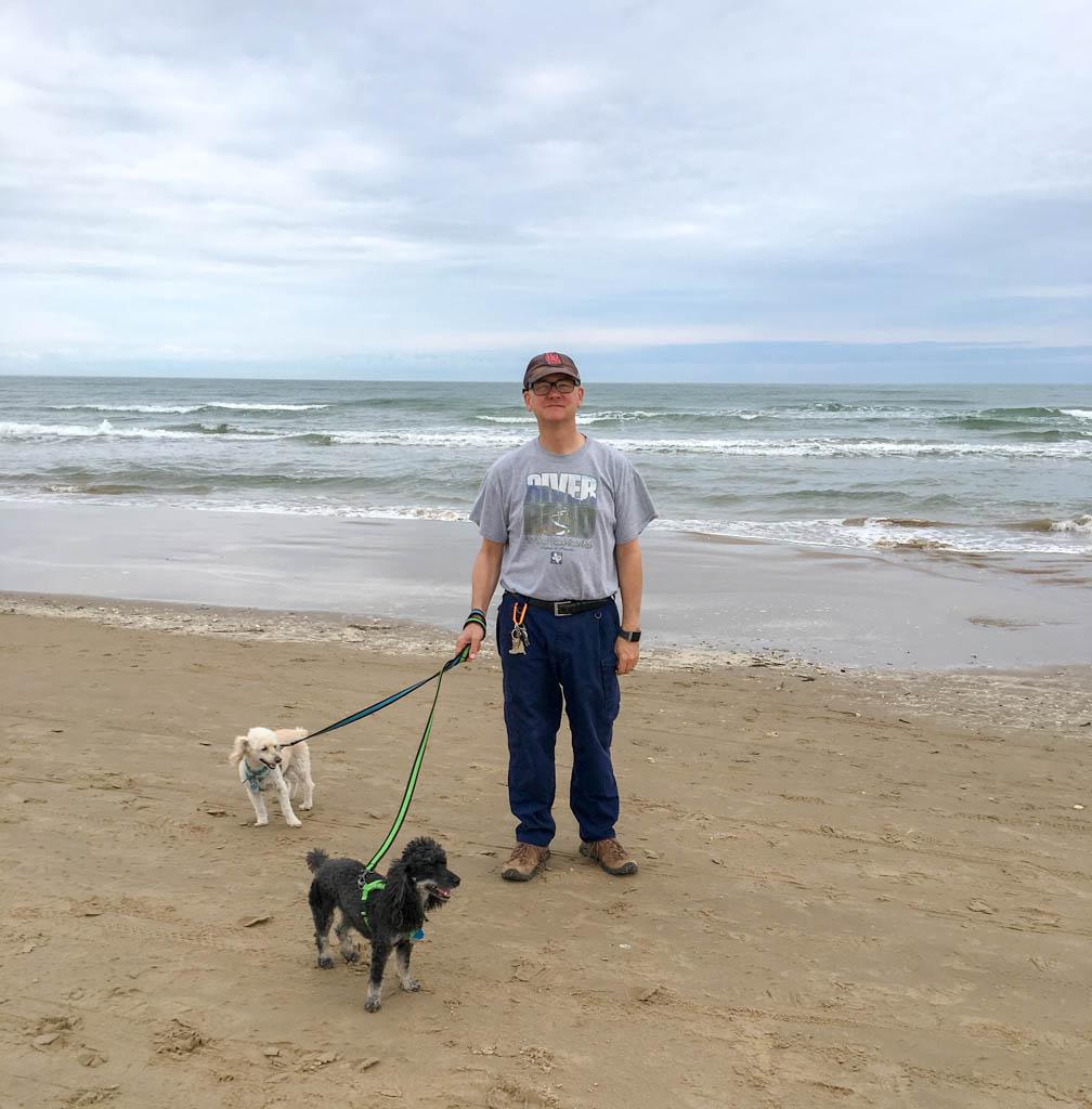 Larry Walks Dogs On Beach