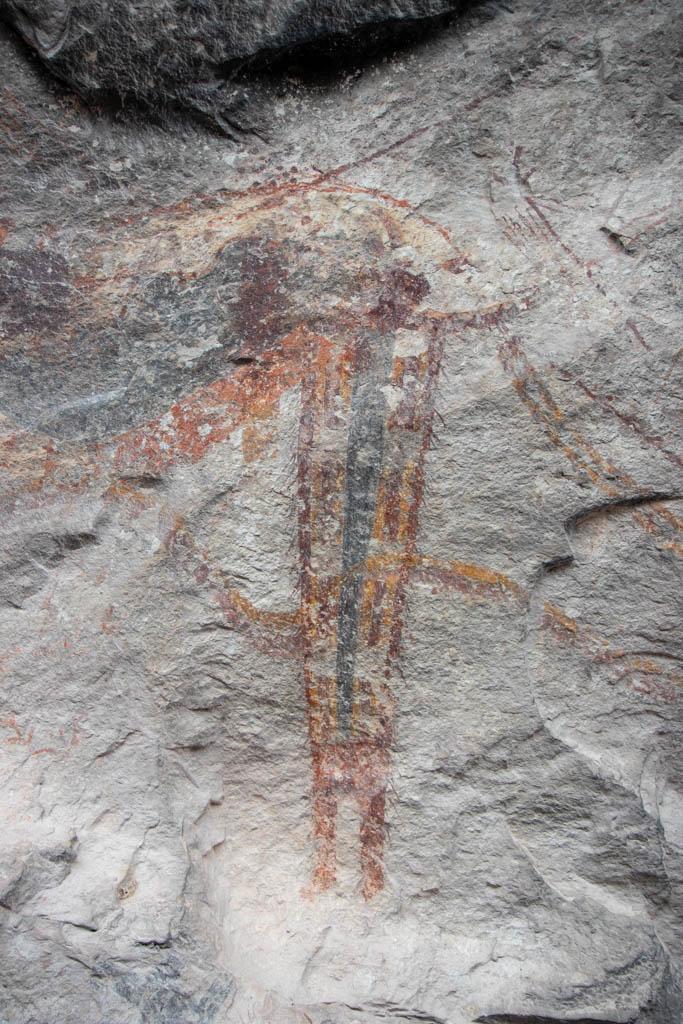 Shaman Figure With Wavy Line Through It