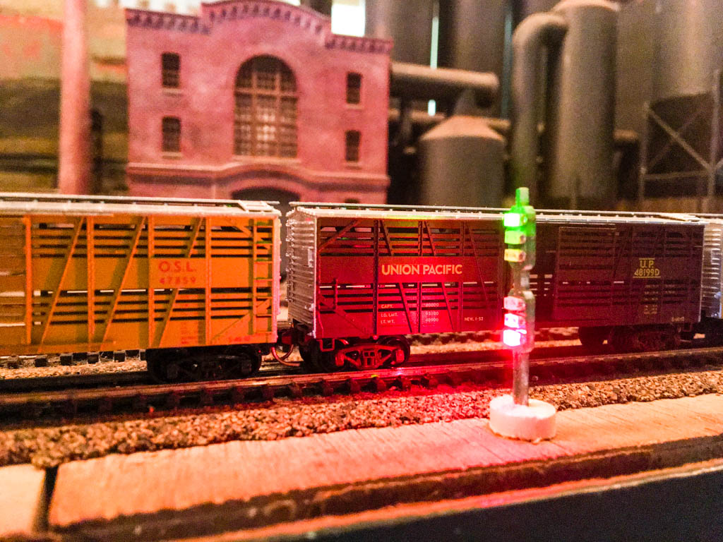 Cattle Cars Passing Train Signal