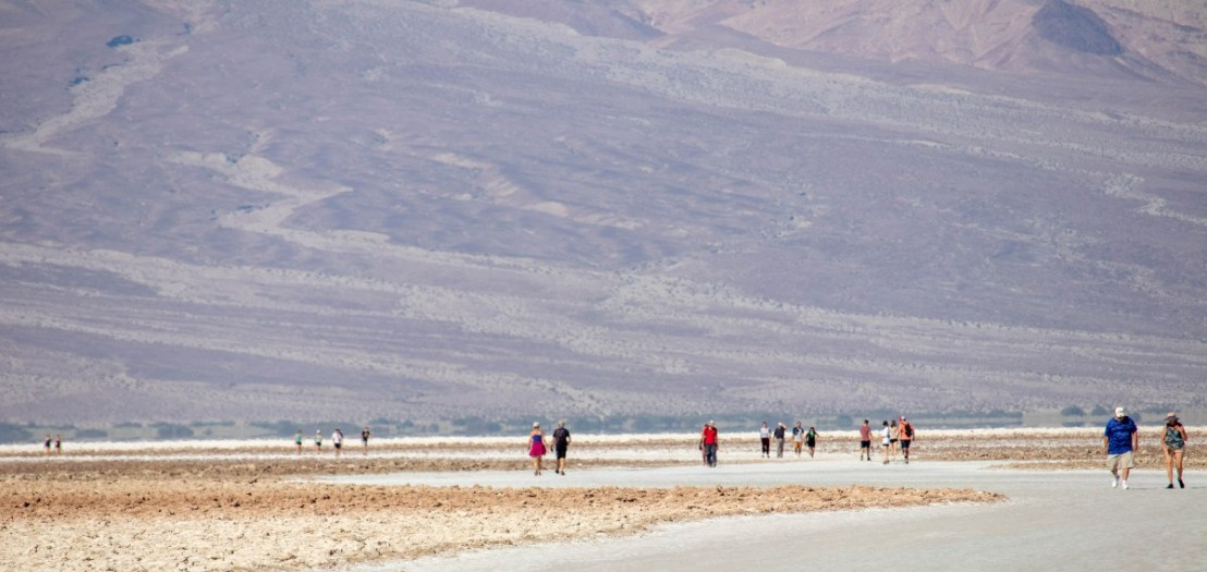 Hikers On Salt Flat Miles Away