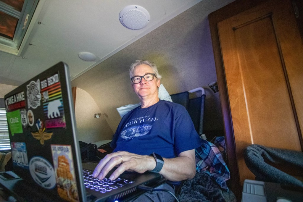 Larry Sitting Up In Bed Working On PC