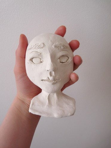 blank sculpt of a paperclay doll head in progress