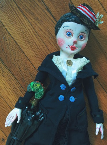 paperclay art doll of mary poppins with her parrot-headed umbrella