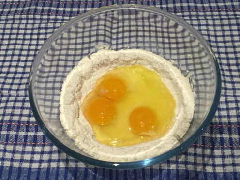 Add the eggs and sugar In the well