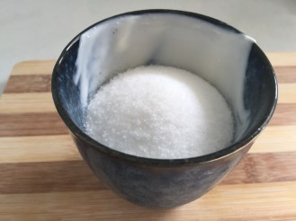 Two pots of sugar.