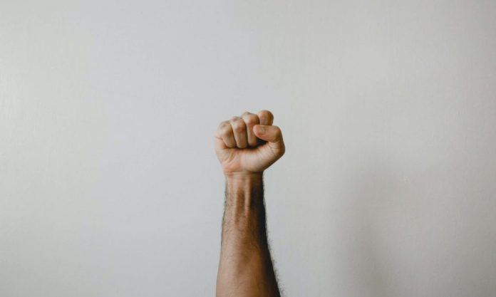 persons right arm on white wall