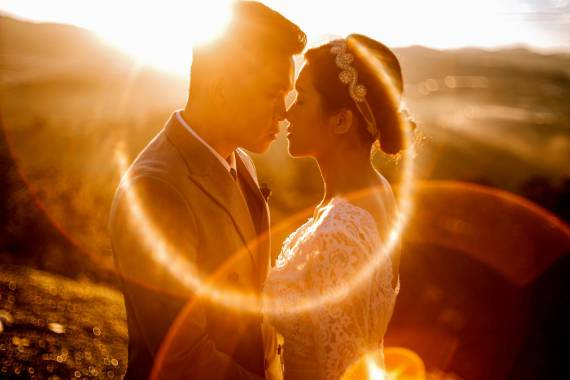 sensual ethnic newlyweds in sunny evening