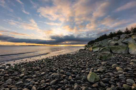 photo of rocky shore during sunset