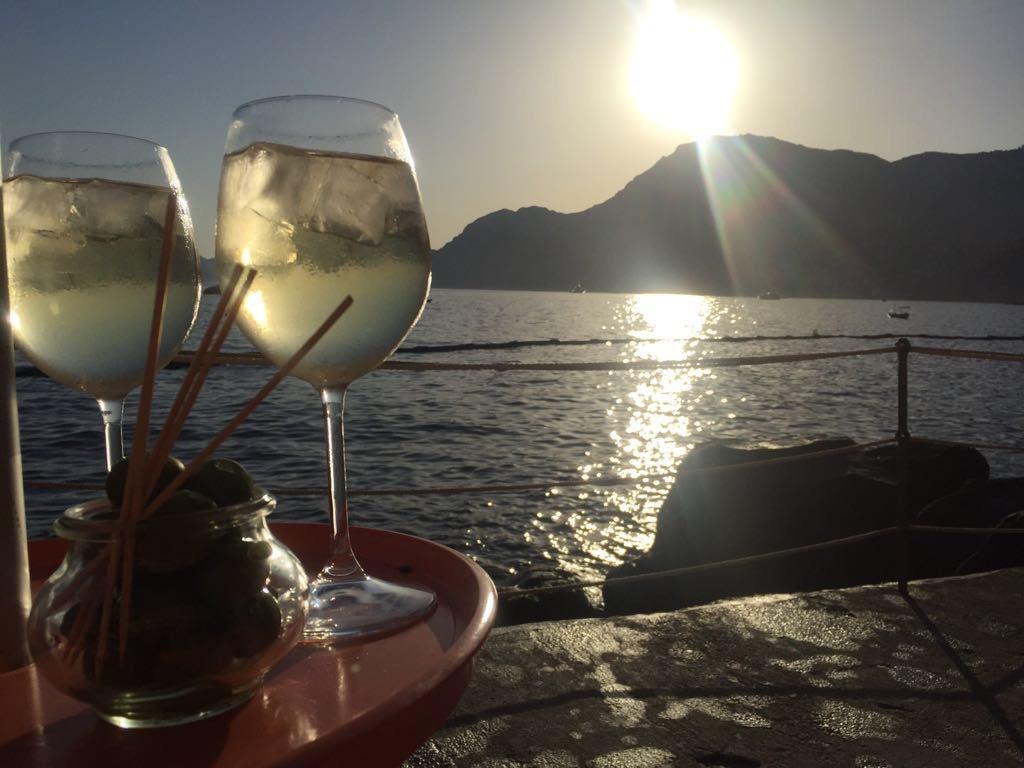 Aperitif on sunset. Gavitella beach Positano