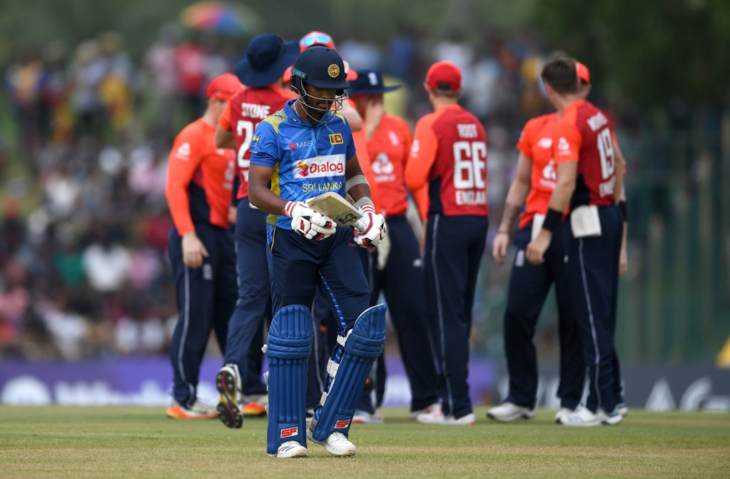DAMBULLA, SRI LANKA - OCTOBER 13:  Sri Lanka captain Dinesh Chandimal leaves the field after being bowled by Chris Woakes of England during the 2nd One Day International match between Sri Lanka and England at Rangiri Dambulla International Stadium on October 13, 2018 in Dambulla, Sri Lanka.  (Photo by Gareth Copley/Getty Images)