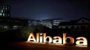 Alibaba cuts sales forecast on economic uncertainty