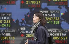 Asian shares mostly higher after Wall Street buying spree