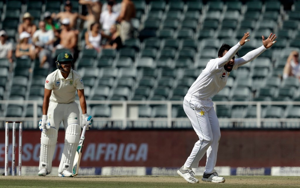 Pakistan's batsman Faheem Ashraf, right, successfully appeals for LBW against South Africa's bowler Zubayr Hamza on day two of the third cricket test match between South Africa and Pakistan at the Wanderers stadium in Johannesburg, South Africa, Saturday, Jan. 12, 2019. (AP Photo/Themba Hadebe)