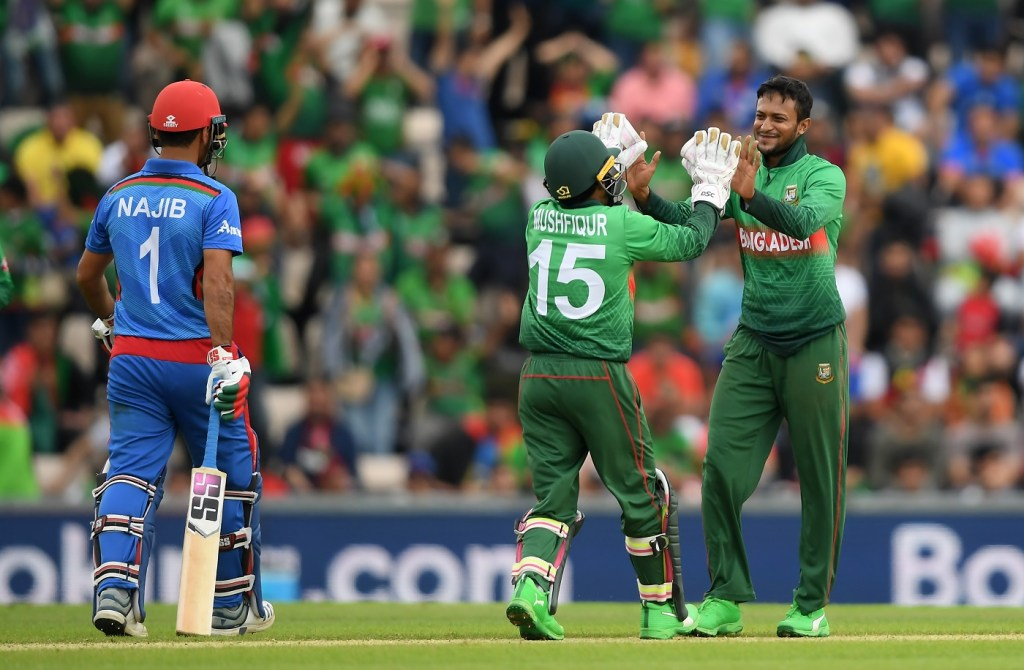 SOUTHAMPTON, ENGLAND - JUNE 24: Shakib Al Hasan of Bangladesh celebrates taking the wicket of Najibullah Zadran of Afghanistan with Mushfiqur Rahim of Bangladesh during the Group Stage match of the ICC Cricket World Cup 2019 between Bangladesh and South Africa at The Hampshire Bowl on June 24, 2019 in Southampton, England. (Photo by Alex Davidson/Getty Images)