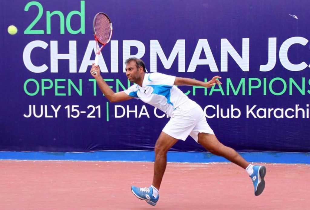 KARACHI:  Aqeel Khan plays a return against Mudassir Murtaza during the  semi finals of 2nd CJCSC Open Tennis Championship 2019.. INP PHOTO