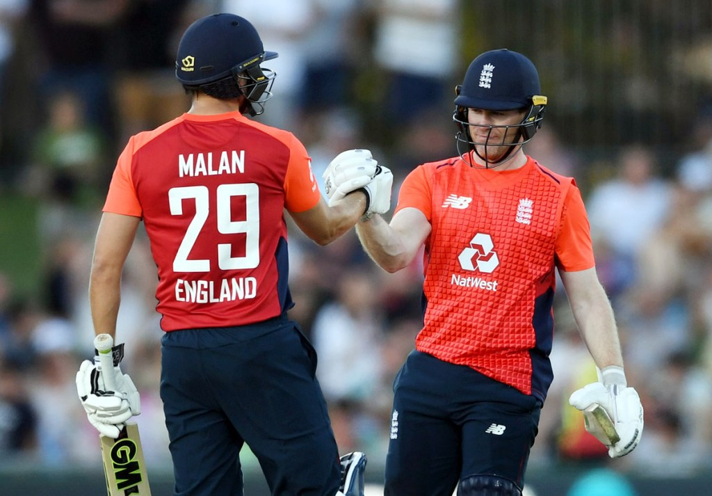 NAPIER, NEW ZEALAND - NOVEMBER 08: Dawid Malan of England celebrates reaching his century with captain Eoin Morgan during game four of the Twenty20 International series between New Zealand and England at McLean Park on November 08, 2019 in Napier, New Zealand. (Photo by Gareth Copley/Getty Images)