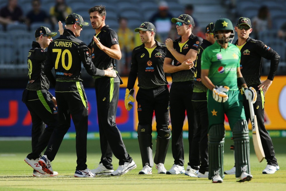 PERTH, AUSTRALIA - NOVEMBER 08: Mitchell Starc of Australia  celebrates after taking the wicket of Babar Azam of Pakistan during game three of the International Twenty20 series between Australia and Pakistan at Optus Stadium on November 08, 2019 in Perth, Australia. (Photo by Will Russell/Getty Images)