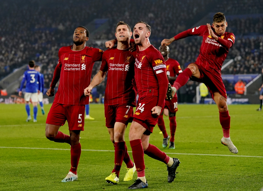 """Soccer Football - Premier League - Leicester City v Liverpool - King Power Stadium, Leicester, Britain - December 26, 2019   Liverpool's James Milner celebrates scoring their second goal with teammates                  REUTERS/Andrew Yates    EDITORIAL USE ONLY. No use with unauthorized audio, video, data, fixture lists, club/league logos or """"live"""" services. Online in-match use limited to 75 images, no video emulation. No use in betting, games or single club/league/player publications.  Please contact your account representative for further details.     TPX IMAGES OF THE DAY"""