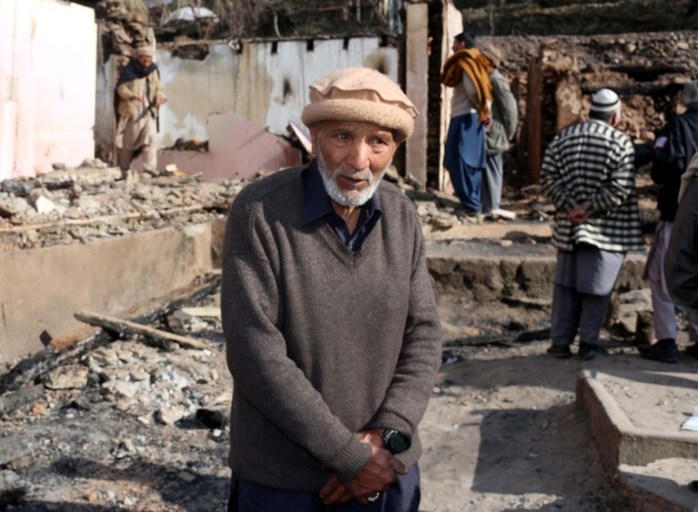 NEELUM VALLEY, PAKISTAN - DECEMBER 23: An elderly Pakistani Kashmiri villager stands on the debris of his house targeted by cross border Indian troops in a village in Neelum Valley on the Line of Control (LoC), some 100 kilometres from Muzaffarabad, the capital of Pakistan-administered Kashmir on December 23, 2019. Pakistani authorities said Sunday that mortars fired by Indian troops into Pakistan's portion of the disputed Kashmir region have killed three civilians and damaged nearly a dozen homes in recent days. ( CHUDARY NASEER - Anadolu Agency )