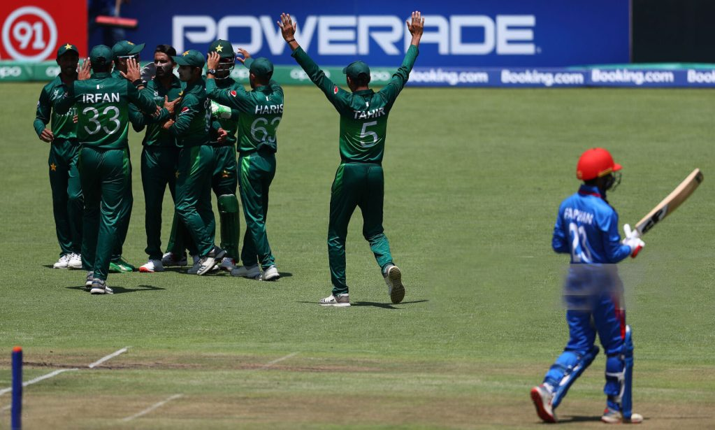 BENONI, SOUTH AFRICA - JANUARY 31: Aamir Ali Thaheem of Pakistan is congratulated on the wicket of Farhan Zakhail of Afghanistan  during the ICC U19 Cricket World Super League Quarter Final match between Afghanistan and Pakistan at Willowmoore Park on January 31, 2020 in Benoni, South Africa. (Photo by Matthew Lewis-ICC/ICC via Getty Images)
